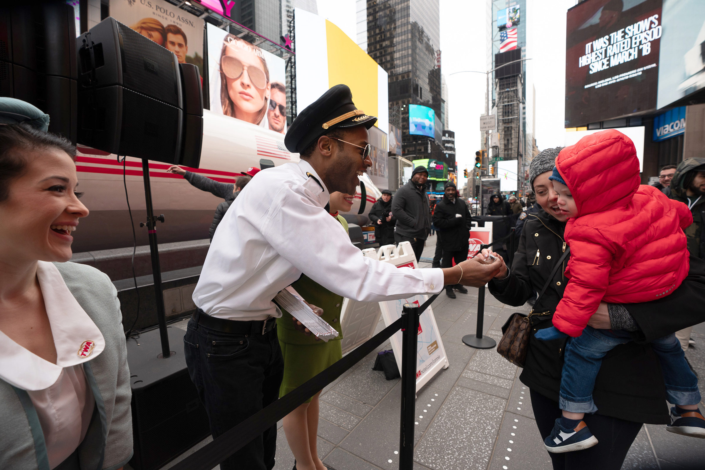 Connie's crew — dressed in authentic vintage TWA uniforms — greet the Times Square crowds on March 23, 2019.
