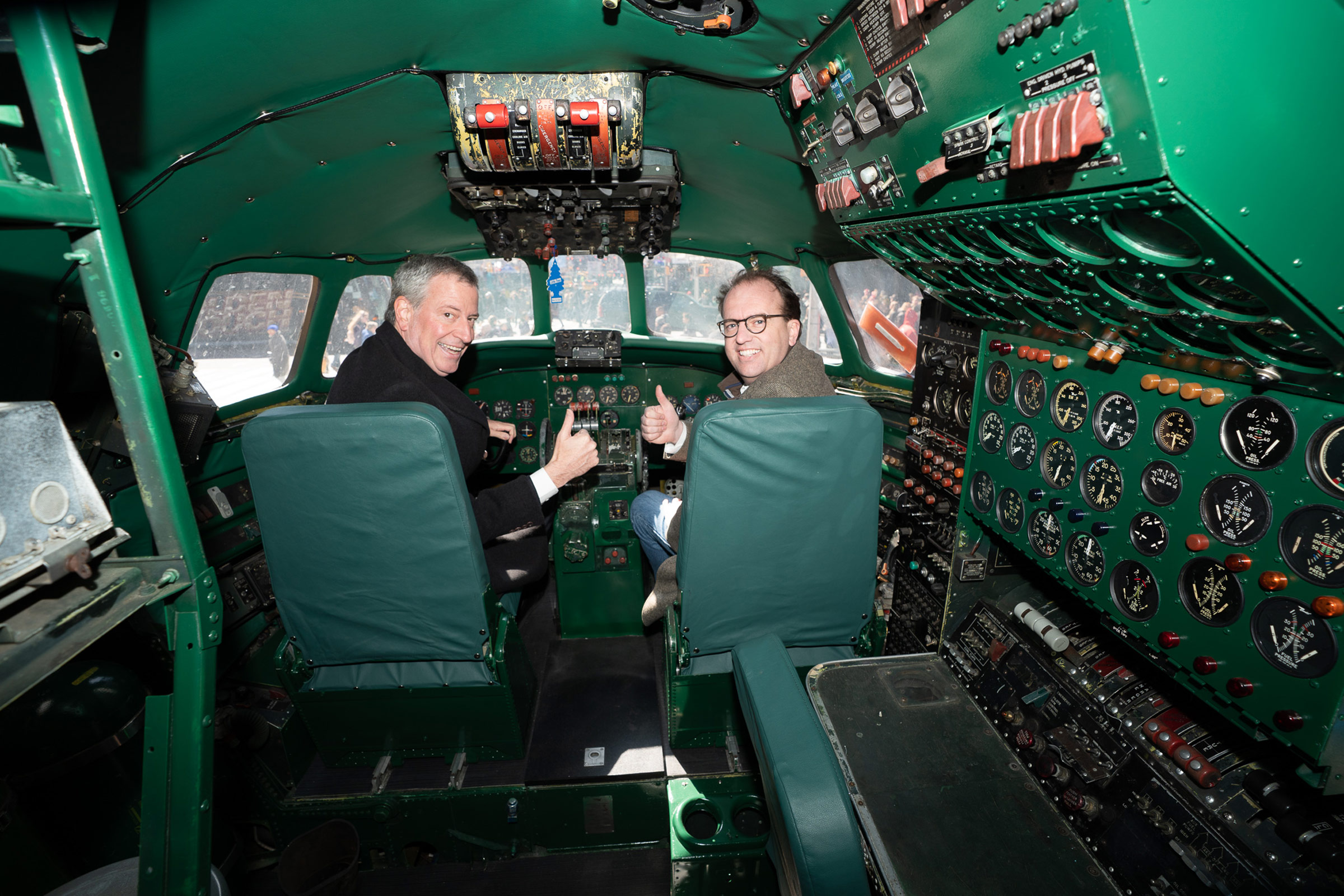 New York City Mayor Bill de Blasio (left) takes the controls in Connie's cockpit with CEO and Managing Partner of MCR and MORSE Development Tyler Morse on March 23, 2019.